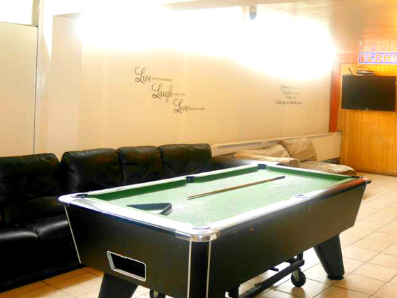 Enjoy a game in the pool room at Kensal Green Backpackers