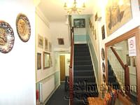 The lobby area and stairway at Hamiltons Hotel
