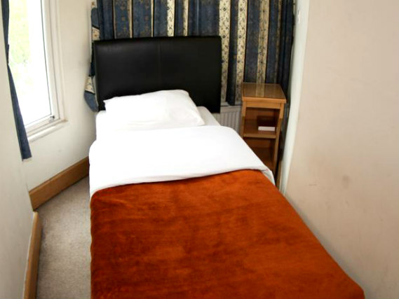 Single rooms at Holland Inn Hotel provide privacy