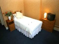 A cosy single Room at Croydon Court Hotel