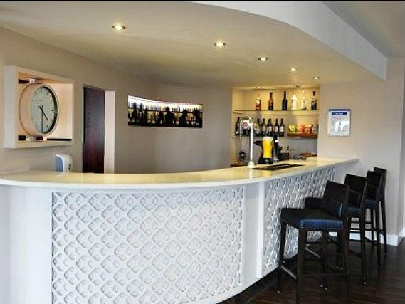 After a busy day, relax with a drink in the bar at Holiday Inn Express Royal Docks