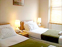 A twin room at Lexham Gardens Hotel