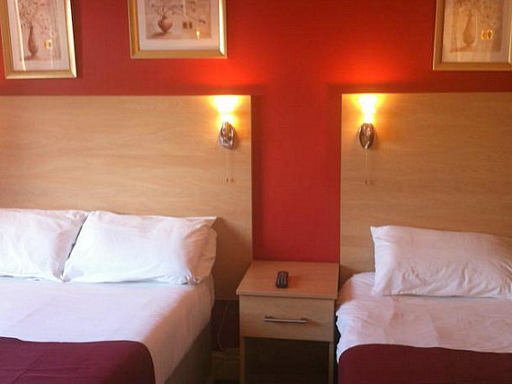 A triple room at City Inn Express
