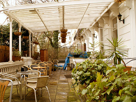 Relax in the garden at Pembridge Palace Hotel London