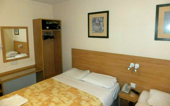 A typical triple room at Colliers Hotel