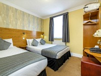A specious triple room at Lidos Hotel with good facilities