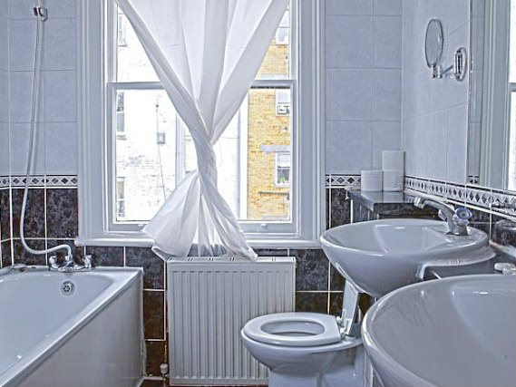 Bathrooms are stylish and modern at Hyde Park Whiteleaf Hotel