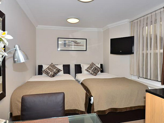 A twin room at Royal Chulan Hyde Park Hotel is perfect for two guests