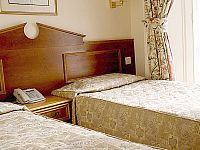 A typical bedroom at Pembridge Palace Hotel London