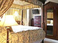 The four poster double bedroom at the Ambassador