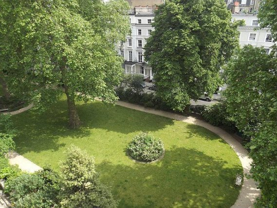 The attractive gardens and exterior of Notting Hill Hostel