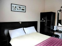 A Typical Double Bedroom at Arriva Hotel